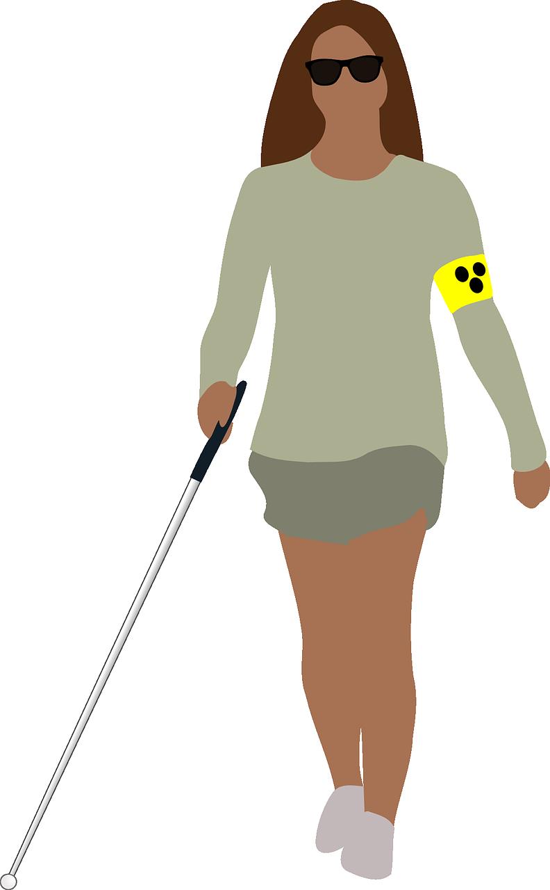 En kvinne med solbriller og en stok